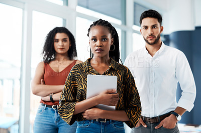 Buy stock photo Cropped portrait of an attractive young businesswoman standing in front of her colleagues and holding a tablet