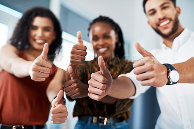 Buy stock photo Cropped portrait of a diverse group of business colleagues standing together in the office and showing a thumbs up