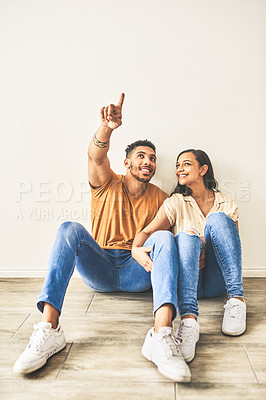 Buy stock photo Shot of a young couple sharing ideas for their new home