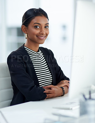 Buy stock photo Portrait of an attractive young businesswoman working on a computer inside her office