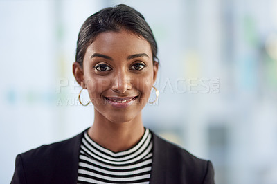 Buy stock photo Portrait of an attractive young businesswoman looking confident and cheerful inside her office at work