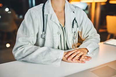 Buy stock photo Cropped shot of a doctor working at her desk during a late night