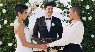 Buy stock photo Cropped shot of an affectionate young lesbian couple smiling at each other while saying their vows on their wedding day