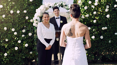 Buy stock photo Rearview shot of an unrecognizable lesbian bride walking towards the altar on her wedding day