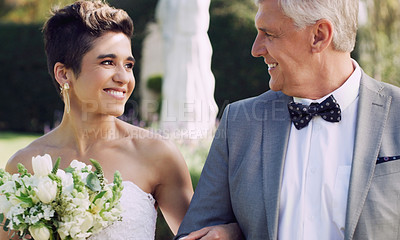 Buy stock photo Cropped shot of an affectionate mature father smiling at his daughter while walking her down the while on her wedding day