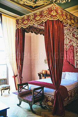 Buy stock photo Still life shot of a canopy bed inside a luxurious hotel room