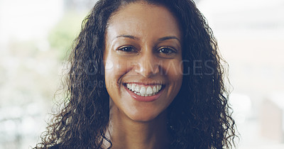 Buy stock photo Cropped portrait of an attractive young businesswoman smiling while standing in a modern office