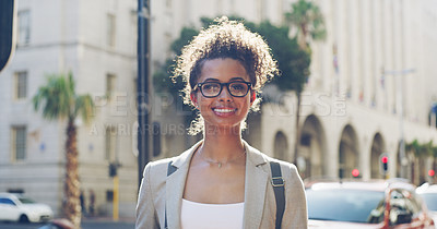 Buy stock photo Cropped shot of an attractive young woman standing alone during a tour of the city