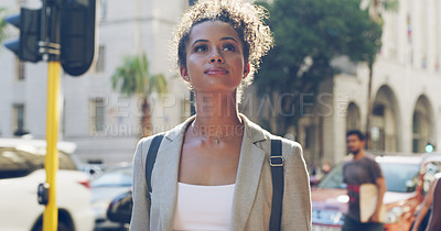 Buy stock photo Cropped shot of an attractive young woman standing alone and looking away during a tour of the city