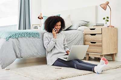 Buy stock photo Full length shot of an attractive young woman sitting on her bedroom floor and using technology at home