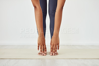 Buy stock photo Cropped shot of a fit woman stretching during her workout routine at home