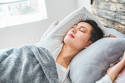 Buy stock photo Cropped shot of a young woman sleeping peacefully in her bed