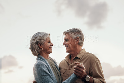 Buy stock photo Cropped shot of an affectionate mature couple dancing together while celebrating a new year outdoors