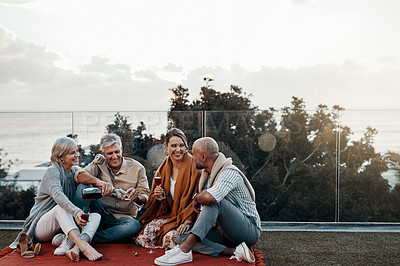 Buy stock photo Full length shot of an affectionate family having wine together while celebrating a new year outdoors