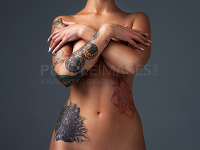 Buy stock photo Cropped shot of a beautiful young woman posing nude in the studio