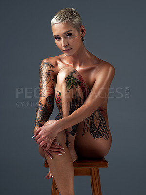 Buy stock photo Cropped portrait of a beautiful young woman posing nude on a stool in the studio