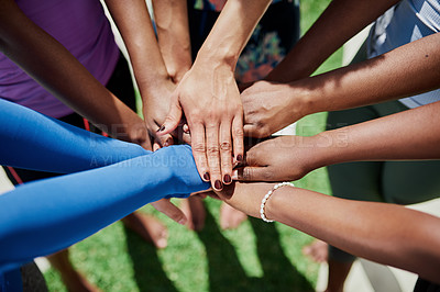 Buy stock photo Cropped shot of a group of women joining their hands in solidarity during a yoga class in a garden