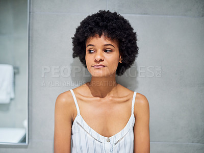 Buy stock photo Cropped shot of a carefree young woman contemplating while standing inside of a bathroom during the morning hours