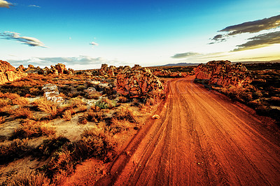 Buy stock photo Shot of a dirt road in an area of deserted land