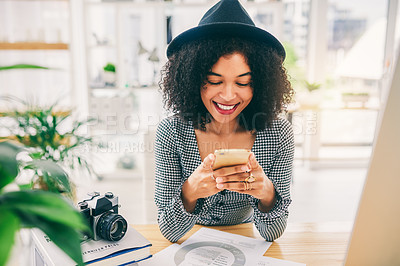Buy stock photo Cropped shot of an attractive young businesswoman using her cellphone at the office