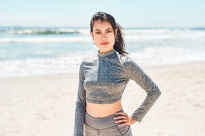 Buy stock photo Shot of a fit young woman having a workout at the beach