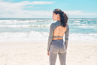 Buy stock photo Rearview shot of a fit young going for a workout at the beach