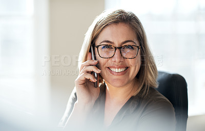 Buy stock photo Portrait of a young businesswoman talking on a cellphone in an office