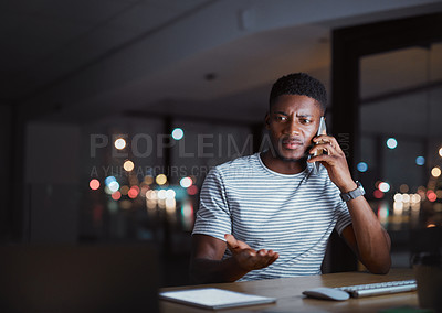 Buy stock photo Cropped shot of a handsome young businessman looking frustrated on a phonecall while working late at night in his office