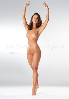 Buy stock photo Shot of a beautiful young woman posing nude against a grey background
