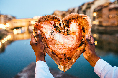 Buy stock photo Cropped shot of an unrecognizable man holding a heart shaped pizza