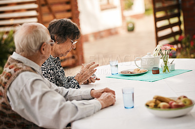 Buy stock photo Cropped shot of a senior woman sitting with her husband and shuffling cards before a game of bridge outdoors