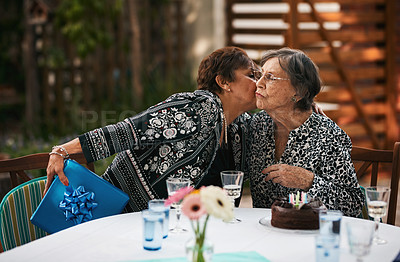 Buy stock photo Cropped shot of a happy senior woman giving her friend a present while they celebrate her birthday outdoors