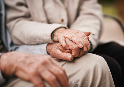 Buy stock photo Cropped shot of an unrecognizable senior couple sitting together and holding hands during a tea party outdoors