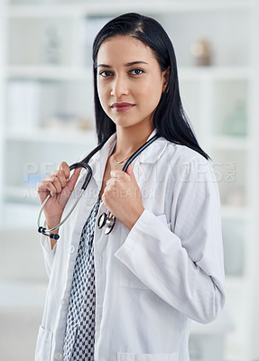 Buy stock photo Portrait of a confident young doctor working in a clinic