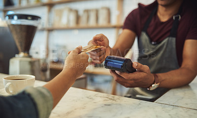 Buy stock photo Closeup shot of an unrecognisable waiter processing a credit card payment from a customer in a cafe