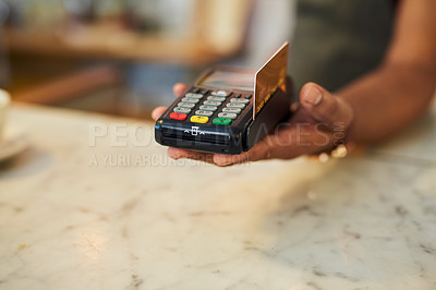 Buy stock photo Closeup shot of an unrecognisable waiter holding a credit card machine in a cafe