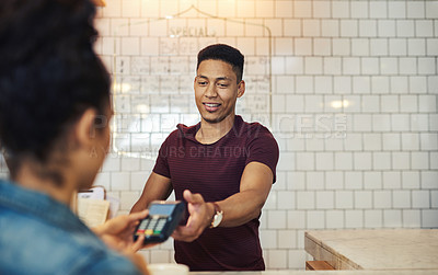 Buy stock photo Shot of a young waiter processing a credit card payment from a customer in a cafe