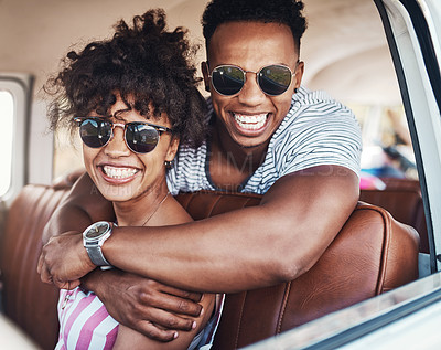 Buy stock photo Cropped shot of a happy young couple out on a road trip together