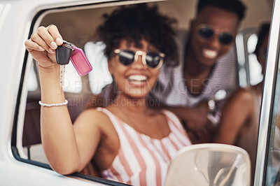 Buy stock photo Shot of a woman holding a set of keys while sitting in a vehicle