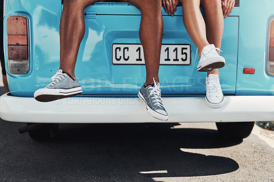 Buy stock photo Shot of an unrecognizable couple taking a break while out on a road trip