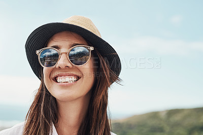 Buy stock photo Cropped shot of an attrative young woman standing outside