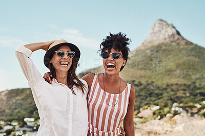 Buy stock photo Cropped shot of two female friends spending the day outdoors