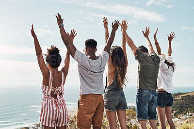 Buy stock photo Cropped shot of a group of friends standing with their hands raised