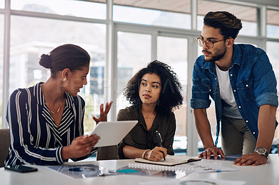 Buy stock photo Cropped shot of a group of young businesspeople having a discussion while working together in a modern office