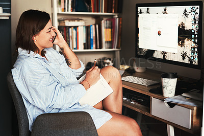 Buy stock photo Cropped shot of an attractive young businesswoman sitting alone in her home office and using her cellphone