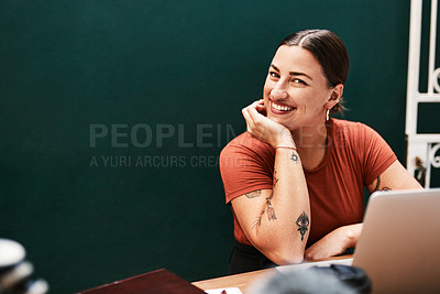 Buy stock photo Cropped shot of an attractive young businesswoman sitting alone at her desk with her hand on her chin