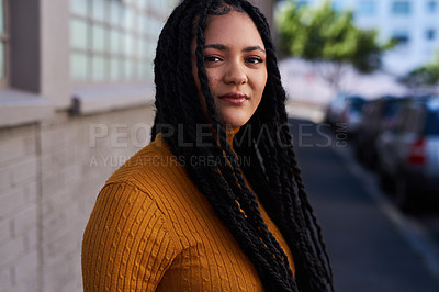 Buy stock photo Cropped shot of a beautiful young woman out in the city during the day