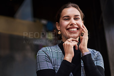 Buy stock photo Cropped shot of a beautiful young woman out in the city