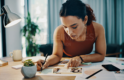 Buy stock photo Cropped shot of a young designer working at her desk