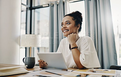 Buy stock photo Shot of a young businesswoman using a digital tablet while working in her home office